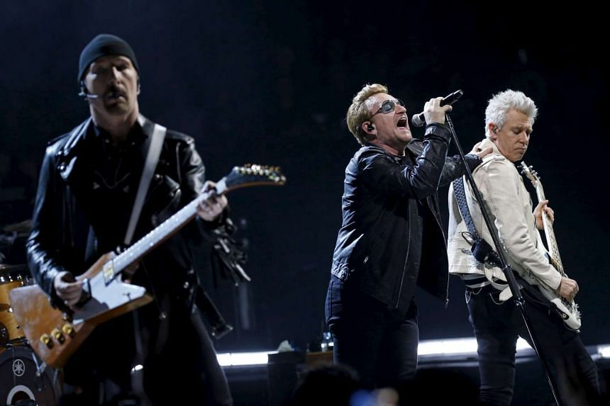 Bono (centre), the Edge (left) and Adam Clayton of Irish band U2 perform at the AccorHotels Arena in Paris on Sunday.