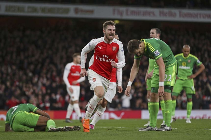 Aaron Ramsey celebrating after scoring the third goal for Arsenal.