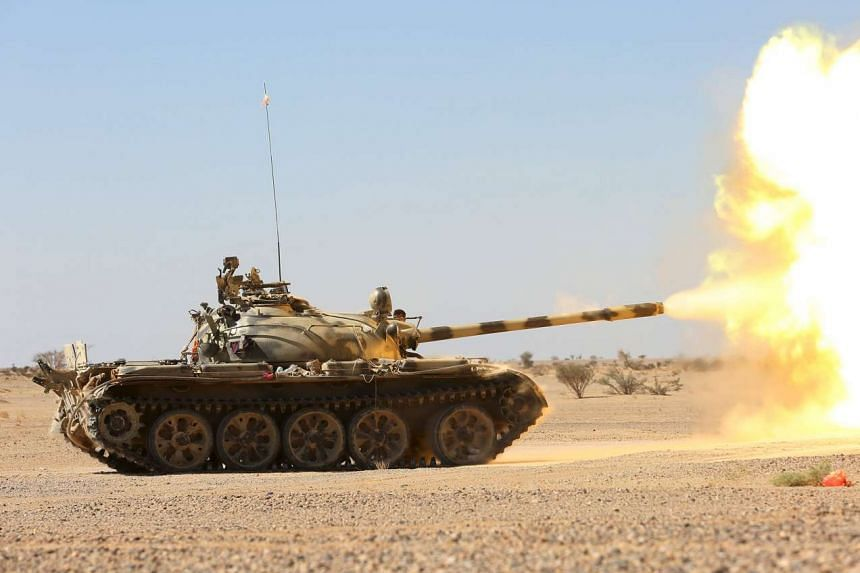 A Yemeni government tank firing at Houthi positions last week. Forces loyal to President Abd-Rabbu Mansour Hadi, backed by air strikes and ground forces from a mainly Gulf Arab coalition, have been locked for nine months in a civil war with the Houth
