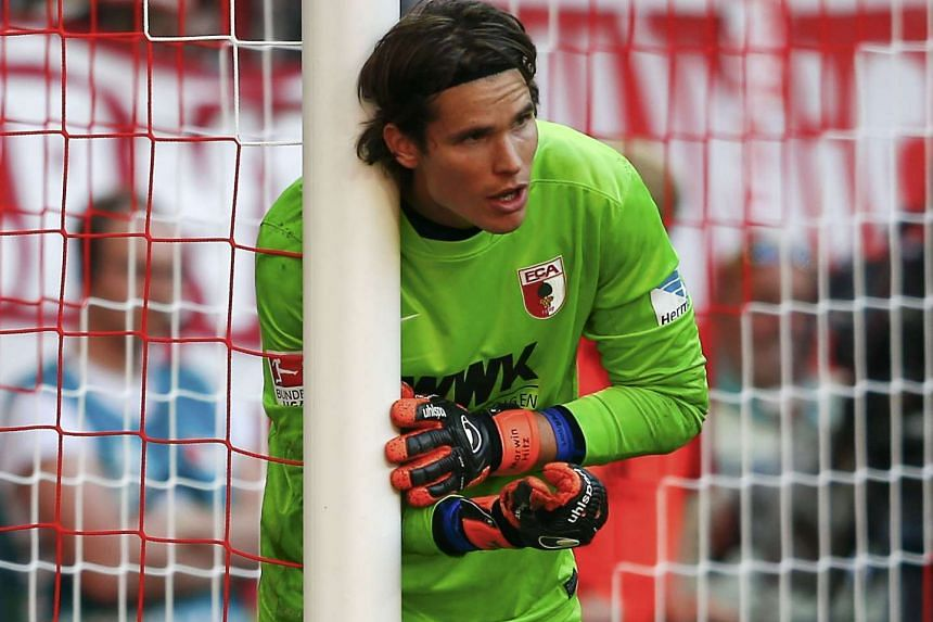 Augsburg goalkeeper Marwin Hitz gestures during their German first division Bundesliga soccer match against FC Bayern on Sept 12, 2015.