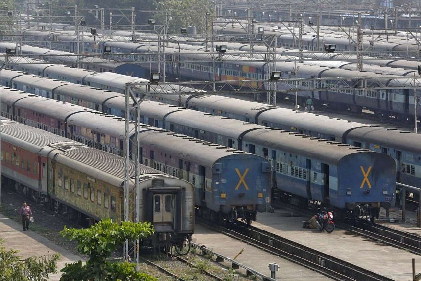 Parked passengers trains are seen at a railway station in Mumbai, India. Japan has offered to finance India's first bullet train.