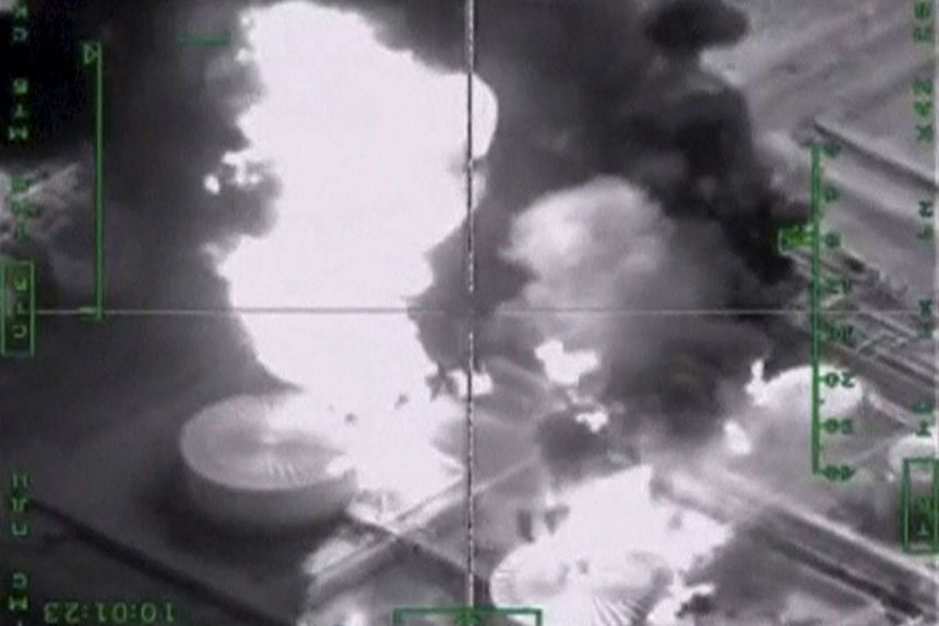 Oil infrastructure in Syria hit by Russian air strikes, in this video still released by Russia's Defence Ministry on Nov 18. PHOTO: REUTERS