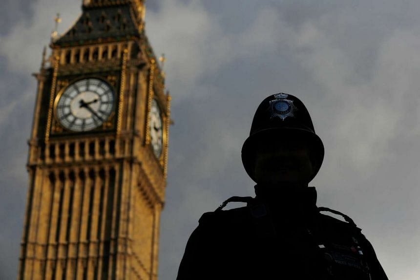A British police officer on patrol near the Houses of Parliament in London on Nov 25, 2015.