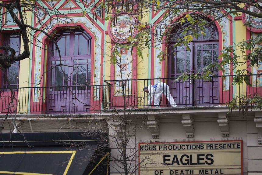 A man is at work during the cleaning process of the Bataclan concert hall.