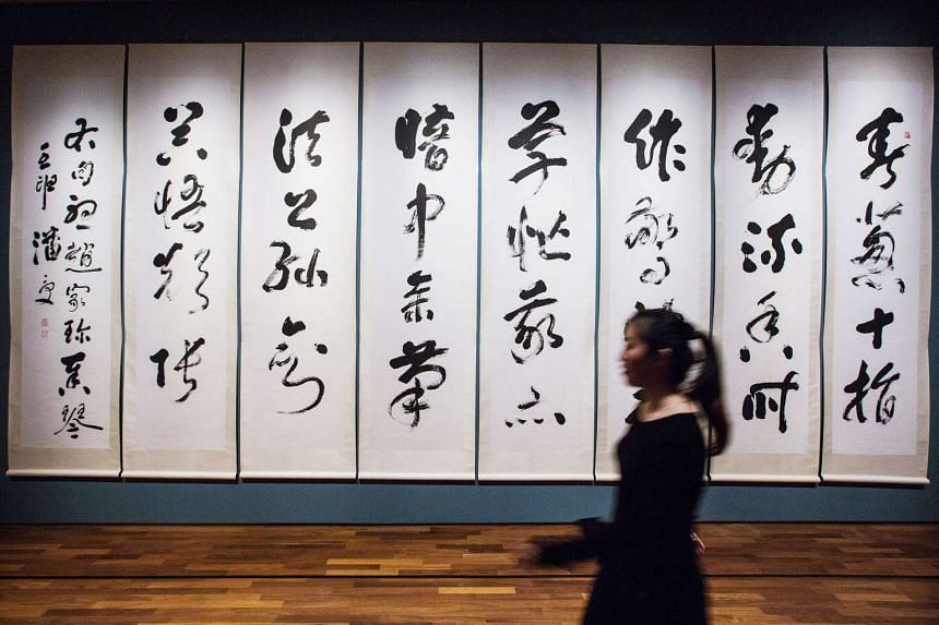 A visitor walks past the work Poem of Zither by artist Pan Shou at the National Gallery Singapore.