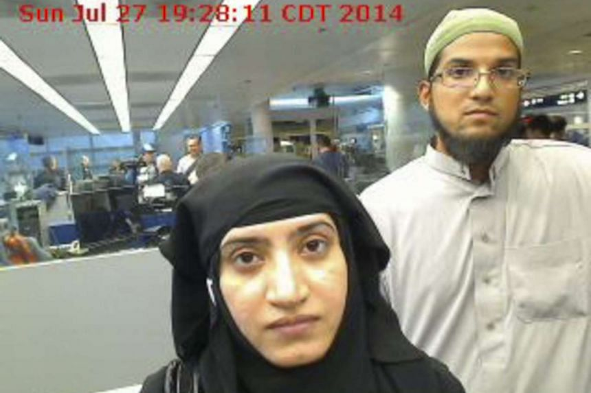 A photograph provided by US Customs and Border Protection (CBP) on Dec 7, 2015 shows Syed Rizwan Farook (R) and Tashfeen Malik (L) arriving at O'Hare International Airport in Chicago, Illinois, USA, on July 24, 2014.
