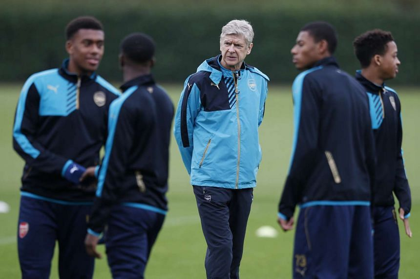 Arsenal players and manager Arsene Wenger (centre) during a training session.