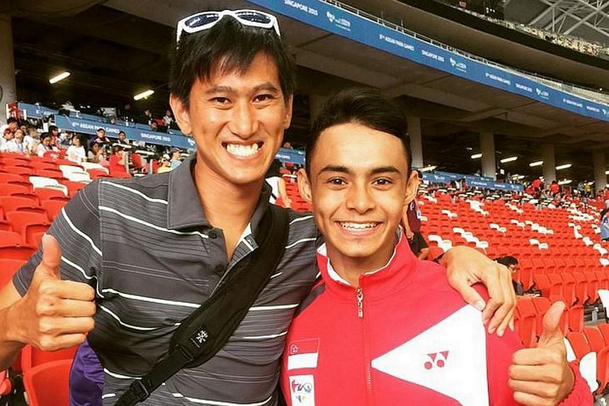 Long jumper Suhairi Suhani with former national high jumper Ronnie Cai yesterday at the National Stadium, after Suhari's silver-winning effort: Big jump at 6.66ms! Congrats for breaking PB and came in silver for Asean Para games! Great Job Suhairi! C
