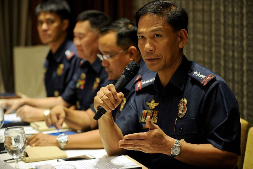 General Ricardo Marquez (right), the Philippines national police chief, speaks during a forum.