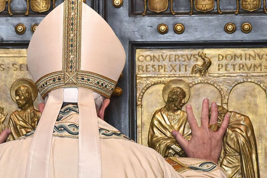"Pope Francis opens a ""Holy Door"" at St Peter's basilica to mark the start of the Jubilee Year of Mercy, on Dec 8, 2015 in Vatican."