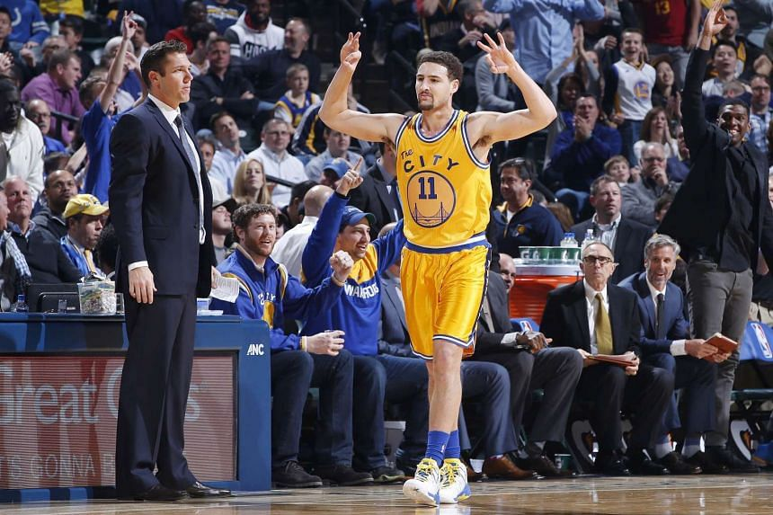 Klay Thompson #11 of the Golden State Warriors reacting after making a three-point basket against the Indiana Pacers in the first half of the game at Bankers Life Fieldhouse on Dec 8, 2015.