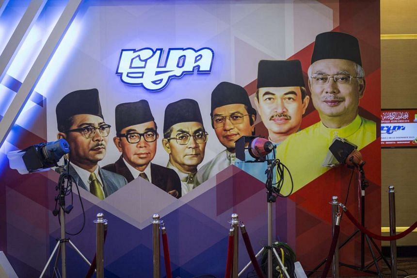 The portrait of Prime Minister Najib Razak (right) and his predecessors are displayed during the UMNO General Assembly on Dec 8, 2015.