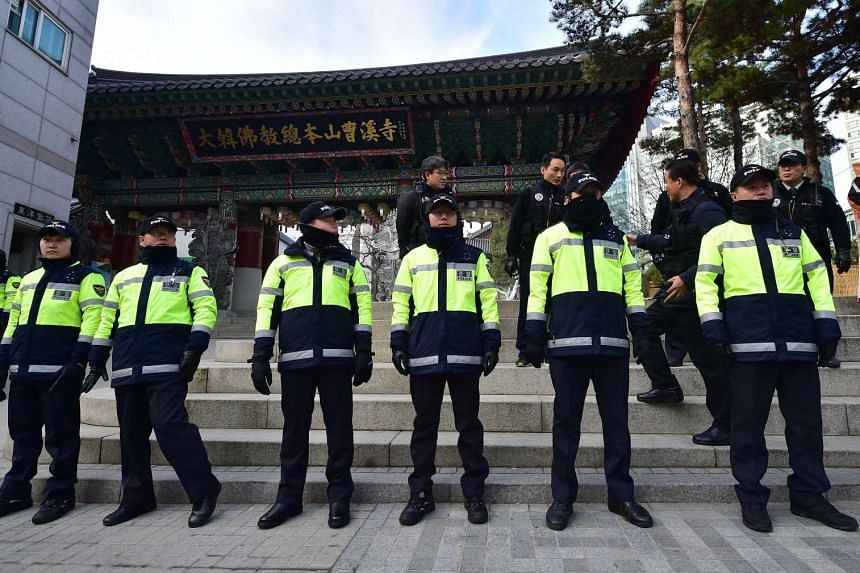 South Korean police standing guard outside the Jogye Temple in downtown Seoul on Dec 9, 2015.