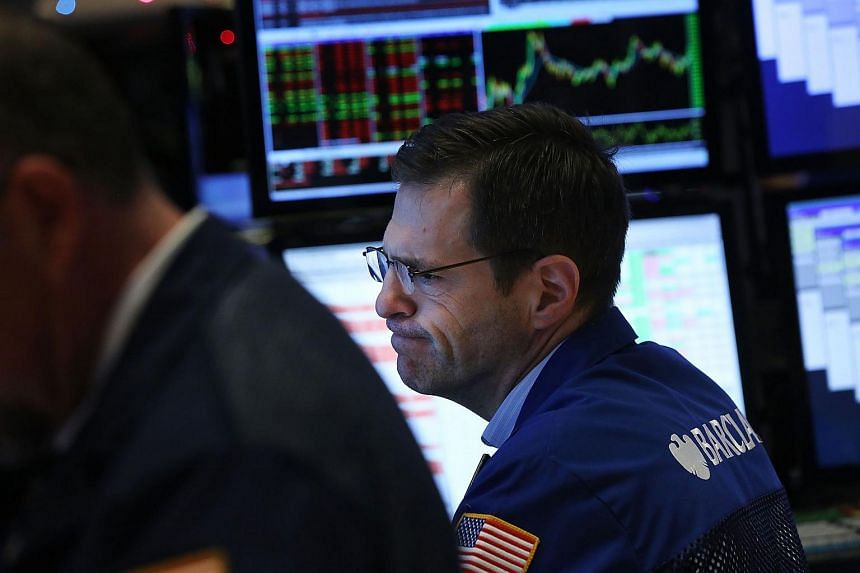 Traders work on the floor of the New York Stock Exchange on Dec 8, 2015.