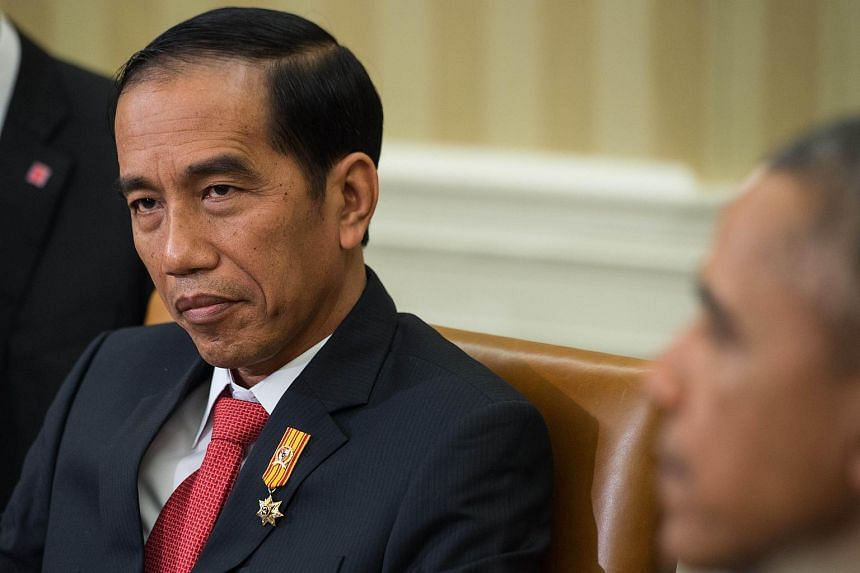 Indonesian President Joko Widodo (left) and US President Barack Obama speak to the press following talks in the Oval Office at the White House in Washington, DC, on Oct 26, 2015.
