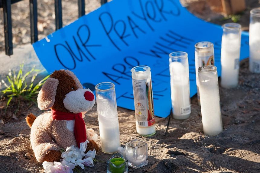 A makeshift memorial outside the Inland Regional Centre in San Bernardino, California, where Syed Farook and his wife Tashfeen Malik shot and killed 14 people.