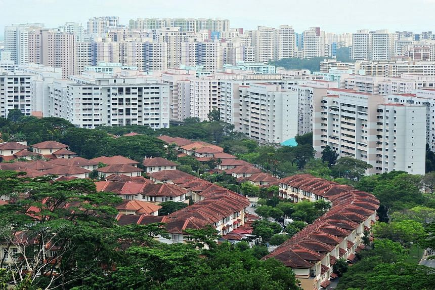 Aerial view of private residences and HDB flats near Tree House condominium.