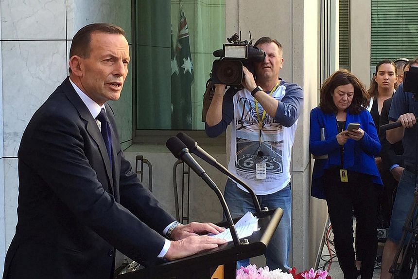 Former Australian PM Tony Abbott speaking to the media at Parliament House in Canberra, on Sept 15, 2015.