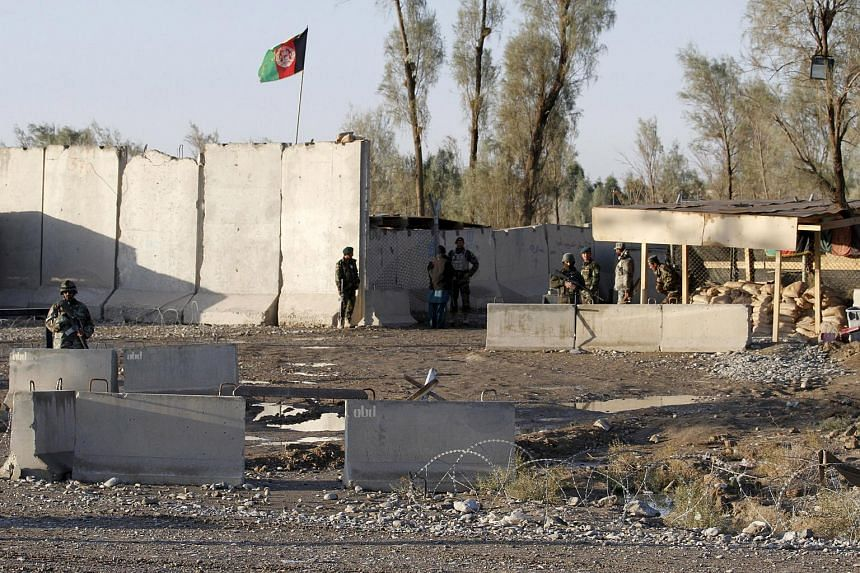 Afghan security forces standing guard at the entrance of Kandahar Airport, which the Taleban stormed on Dec 9, 2015.