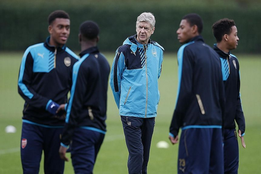 Arsene Wenger (centre) has a proud record in the Champions League - his Arsenal team have qualified for the knockout stages for 15 straight seasons. But he is without key players like Alexis Sanchez and Santi Cazorla for tonight's crucial tie against