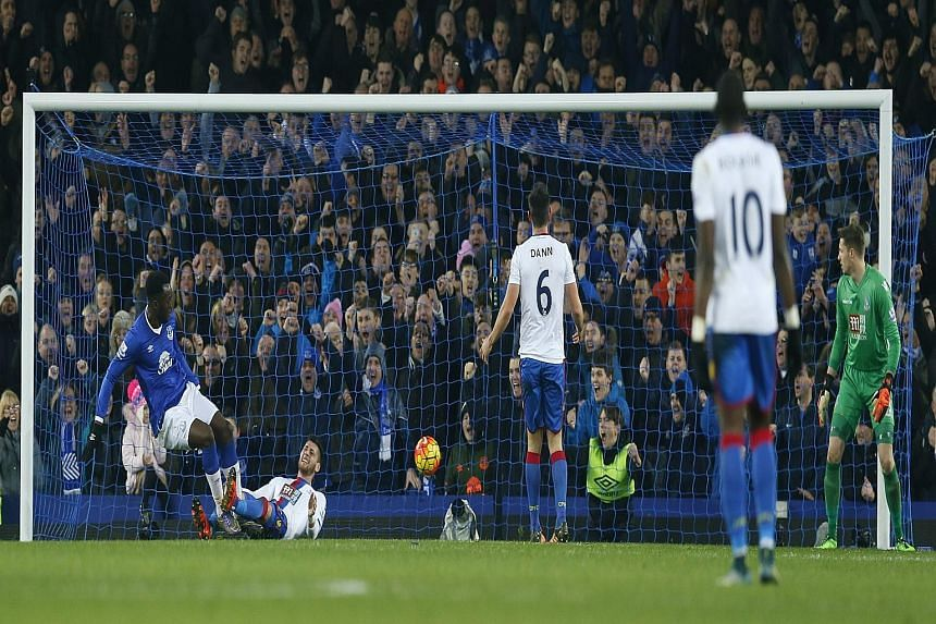Romelu Lukaku (left) netting a late equaliser in his 100th Everton match. His speed gave Palace trouble throughout but the point put the visitors up into sixth place.
