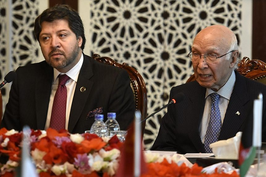 Afghan Deputy Foreign Minister Hekmat Khalil Karzai (left) and Pakistan's National Security Adviser Sartaj Aziz at the Heart of Asia conference yesterday. Warmer ties between the countries are far off.