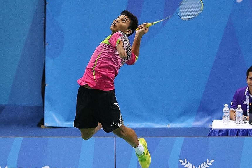 Suryo Nugroho leaping to unleash a smash during the badminton team final against Malaysia. The Indonesian beat world No. 1 Cheah Liek Hou of Malaysia to claim the SU5 men's singles title yesterday.