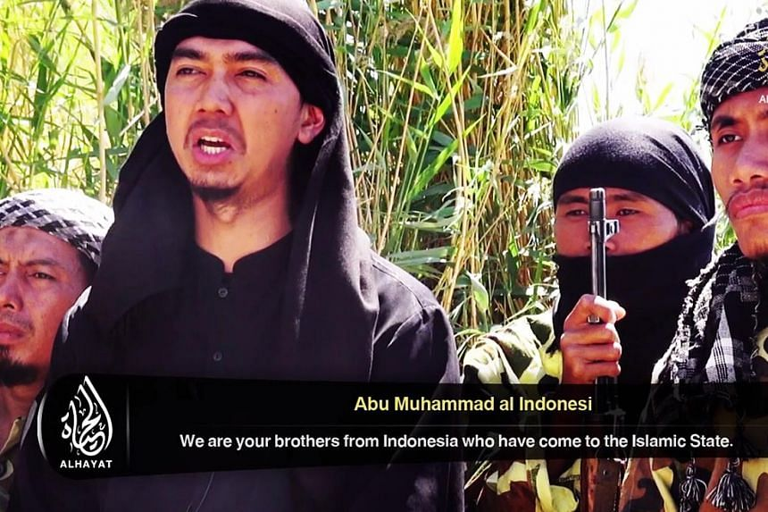 "A group of Indonesian men in a recruitment video released by the Islamic State in Iraq and Syria, urging Indonesian Muslims to join the militants' fight. Research by TSG shows ""at least 600 South-east Asians fighting in Syria"". The sheer number of pe"