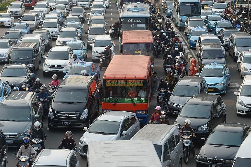Uber yesterday said it has received the green light to operate in Jakarta (left), after giving assurances that it would comply with local tax rules and other requirements.