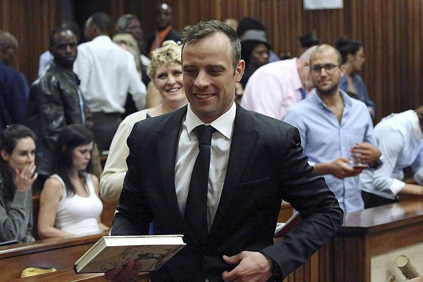 Pistorius leaving the courtroom in Pretoria after he was granted bail yesterday. He will appeal against his conviction for the murder of his girlfriend, and could face a 15-year jail term if that fails.