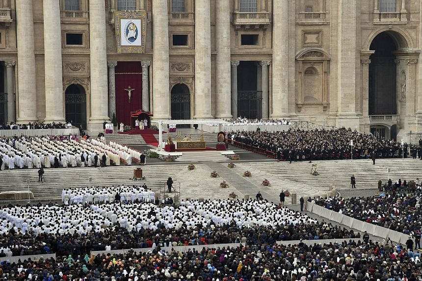 Pope Francis saying Mass in St Peter's Square yesterday, the start of the Roman Catholic Church's Jubilee Year of Mercy. The first pilgrims had gathered in the square before dawn to witness the event, held under unprecedented security in the wake of