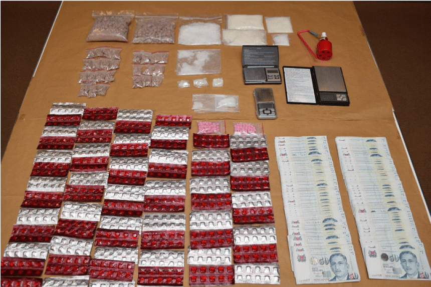Drug paraphernalia and cash seized from CNB operation on Dec 8, 2015.