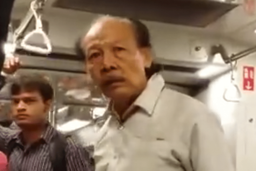The man can be seen shouting in a crowded MRT train and having a heated exchange in Malay with a woman.
