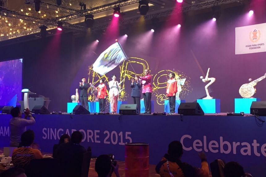 The ASEAN Para Games flag is passed on to Malaysia.