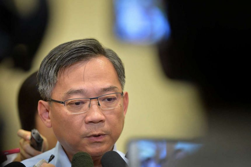 Health Minster Gan Kim Yong speaking to reporters on Tuesday (Dec 8).