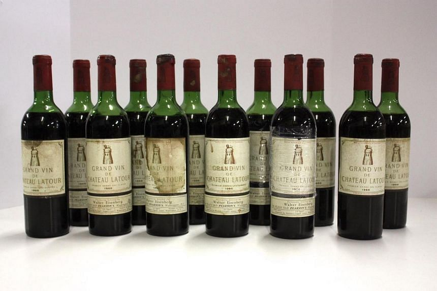 Bottles of 1966 Chateau Latour from wine counterfeiter Rudy Kurniawan's collection up for auction.