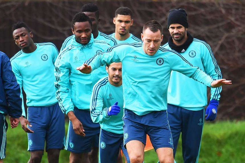 John Terry (front) returning from an ankle injury and training with the Chelsea squad ahead of their Champions League clash with Porto at Stamford Bridge.
