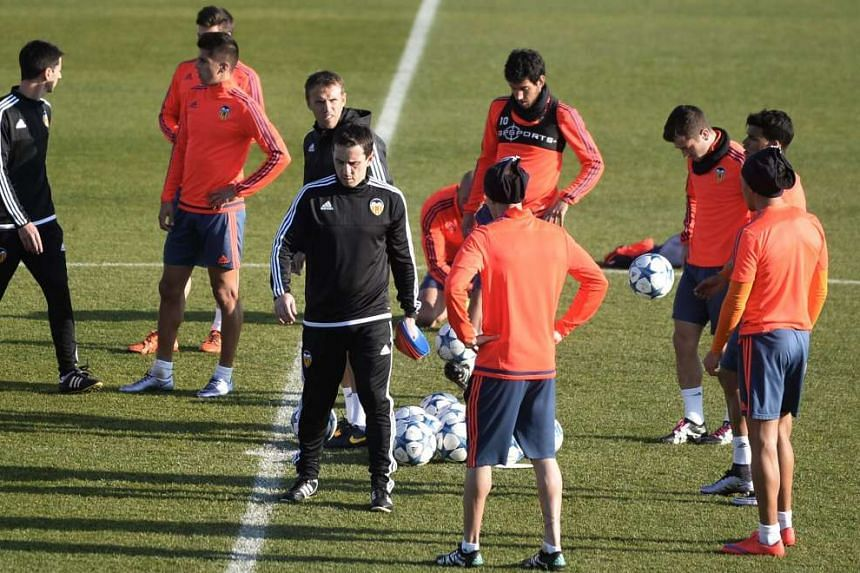 Valencia head coach Gary Neville (left), with younger brother Phil, the assistant coach, behind him at training. Valencia need to beat Lyon and hope Gent do not defeat Zenit, to advance in the Champions League.