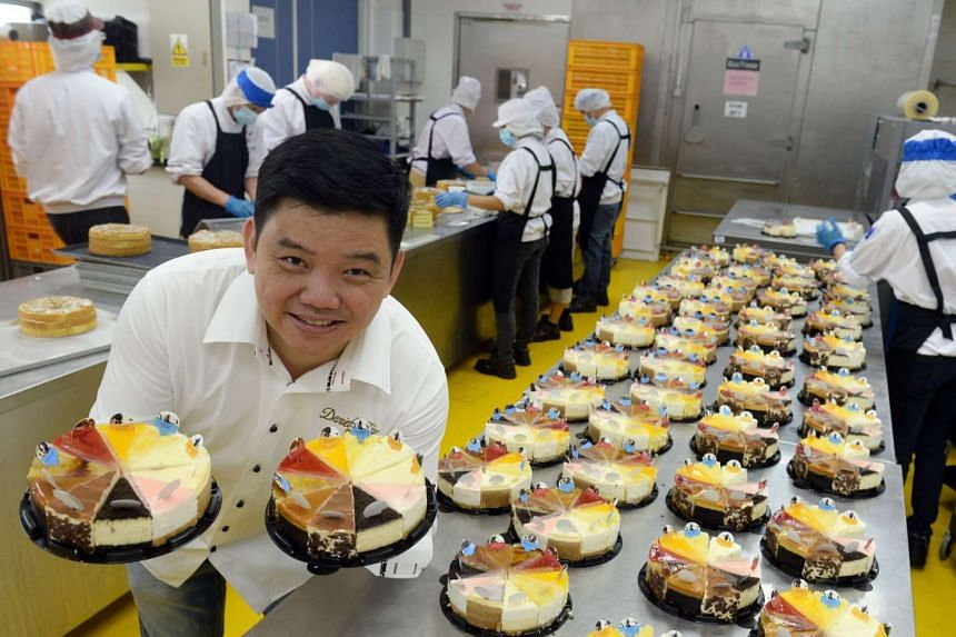 Chef Daniel Tay in the kitchen of online cheesecake shop Cat & the Fiddle, where more than 3,000 cakes are made every month.