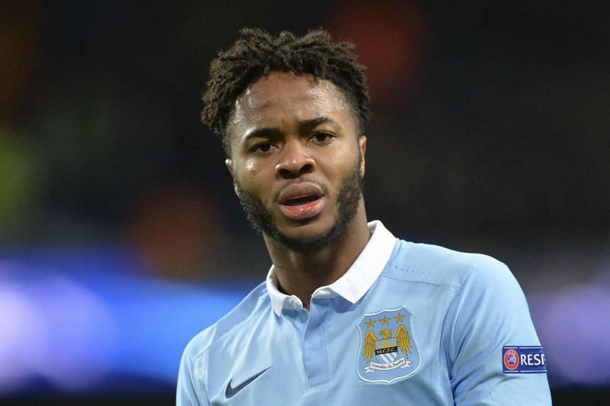 Manchester City's English midfielder Raheem Sterling reacts after missing a chance.