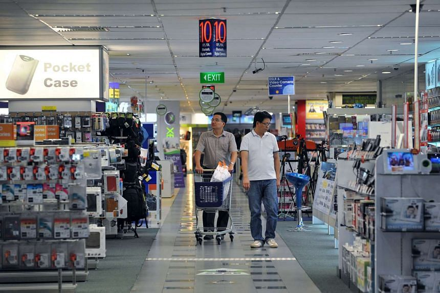 Shoppers at Challenger's flagship store at Funan DigitaLife Mall in 2011.