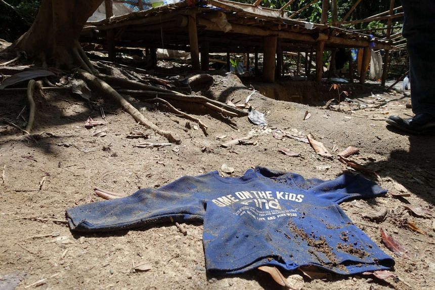 A child's shirt in the abandoned trafficker camp near Ban Taloh in Padang Besar, by the Thai-Malaysian border.