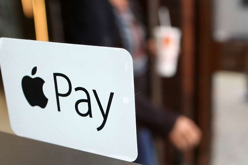A sign for the launch of the Apple pay system, from Apple Inc seen at a McDonald's restaurant in London, UK, on Jul 14, 2015.