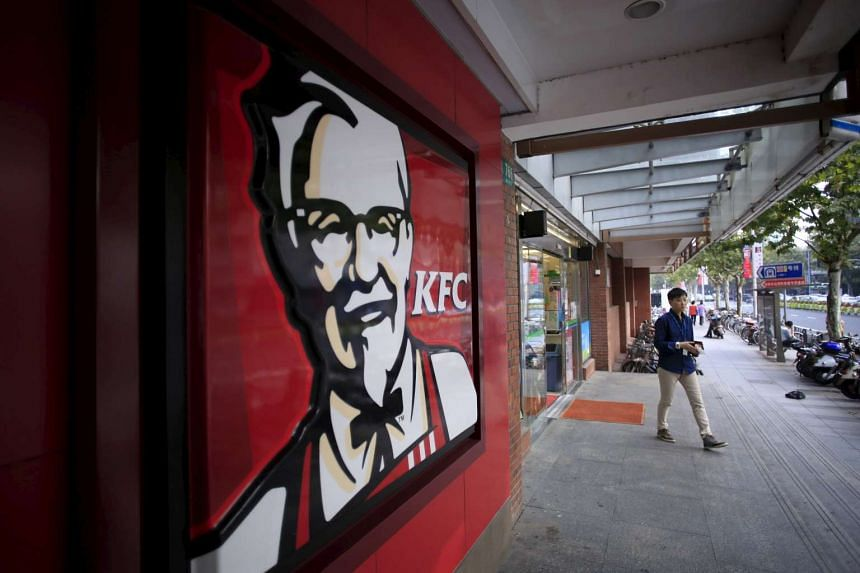A customer outside a KFC restaurant in Shanghai, China, on Oct 9, 2015.