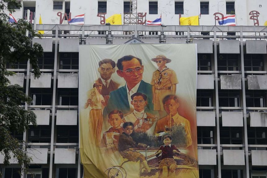 A banner with pictures of Thai King Bhumibol Adulyade hangs at Siriraj hospital.