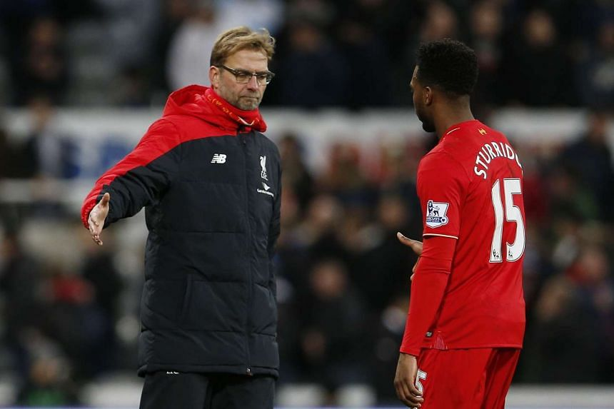 Liverpool manager Juergen Klopp reaching out to shake hands with striker Daniel Sturridge after their Premier League loss to Newcastle United at St James' Park on Dec 6, 2015.