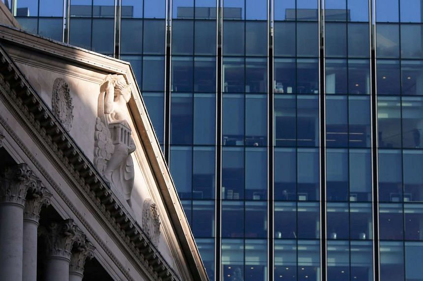 The Bank of England (left) in the city of London.