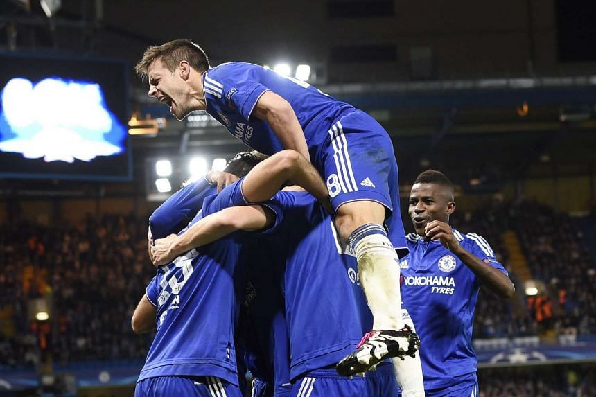 Chelsea's players celebrate after Willian scored their second goal against Porto.