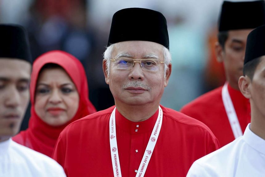 Malaysia's Prime Minister Najib Razak inspects Umno youth during the annual assembly at the Putra World Trade Centre in Kuala Lumpur on Dec 10, 2015.