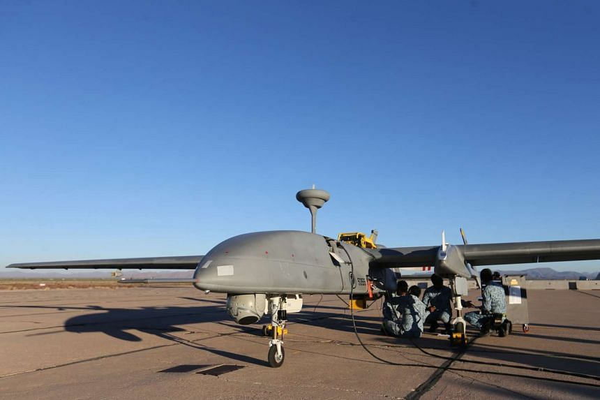 UAV Command personnel going through maintenance checks on the Heron 1 UAV.